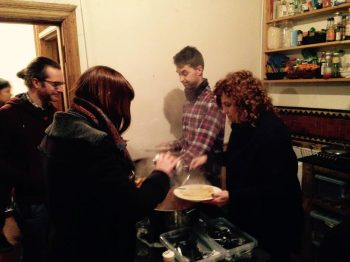 Daniel and Maria serving dinner at the Field Kitchen, 20 Jan 2016. Photo by Becky Davies.