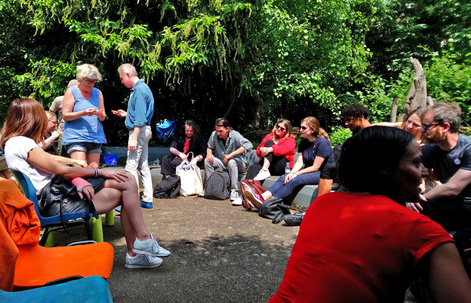 Group discussion on art and gentrification in the Old Tidemill Garden, Reginald Road. Photo by Ruth Gilburt.